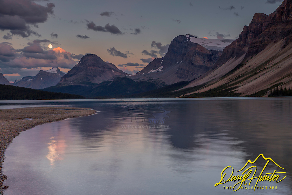 Rising moon over Bow Lake in the Canadian Rockies of Banff National Park.  This stunning alpine lake is north of Lake Louise along the Icefields Parkway.
