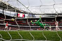 Aston Villa's Brad Guzan is beaten by a strike by Arsenal's Theo Walcott (obscured) to make the score 3-0<br /> <br /> Photographer /Craig MercerCameraSport<br /> <br /> Football - Barclays Premiership - Arsenal v Aston Villa - Sunday 1st February 2015 - The Emirates Stadium - London<br /> <br /> © CameraSport - 43 Linden Ave. Countesthorpe. Leicester. England. LE8 5PG - Tel: +44 (0) 116 277 4147 - admin@camerasport.com - www.camerasport.com