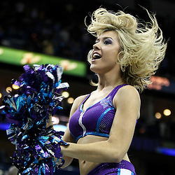 April 6, 2011; New Orleans, LA, USA; A New Orleans Hornets Honeybees dancer performs during the fourth quarter of a game against the Houston Rockets at the New Orleans Arena. The Hornets defeated the Rockets 101-93 and clinched a playoff spot with the victory.   Mandatory Credit: Derick E. Hingle-US PRESSWIRE