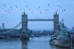 © Licensed to London News Pictures. 19/06/2016. Around 40 hot air balloons have floated over the capital this morning for the Lord Mayor's Hot Air Balloon Regatta. The Official Balloon Event of the City of London supporting the Lord Mayor's Appeal took off from Burgess Park on a cloudy morning in South London and moved across East London to land in Essex. Credit : Rob Powell/LNP