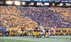 Oct 2, 2021; Morgantown, West Virginia, USA; West Virginia Mountaineers quarterback Jarret Doege (2) drops back for a pass during the fourth quarter against the Texas Tech Red Raiders at Mountaineer Field at Milan Puskar Stadium. Mandatory Credit: Ben Queen-USA TODAY Sports