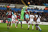 Adrian, the West Ham Utd goalkeeper fumbles the ball as his teammate James Collins tries to head clear. Barclays Premier league match, Swansea city v West Ham Utd at the Liberty Stadium in Swansea, South Wales  on Sunday 20th December 2015.<br /> pic by  Andrew Orchard, Andrew Orchard sports photography.