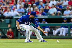 May 8, 2018 - Arlington, TX, U.S. - ARLINGTON, TX - MAY 08: Texas Rangers starting pitcher Mike Minor (36) goes for a bunt during the game between the Texas Rangers and the Detroit Tigers on May 08, 2018 at Globe Life Park in Arlington, Texas. Detroit defeats Texas 7-4. (Photo by Matthew Pearce/Icon Sportswire) (Credit Image: © Matthew Pearce/Icon SMI via ZUMA Press)