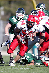 04 October 2008: Jake Smith breaks through the line and into the secondary in a battle between the Carthage Red Men and the Illinois Wesleyan University Titans, Game action was at Wilder Field on the campus of Illinois Wesleyan University in Bloomington Illinois.