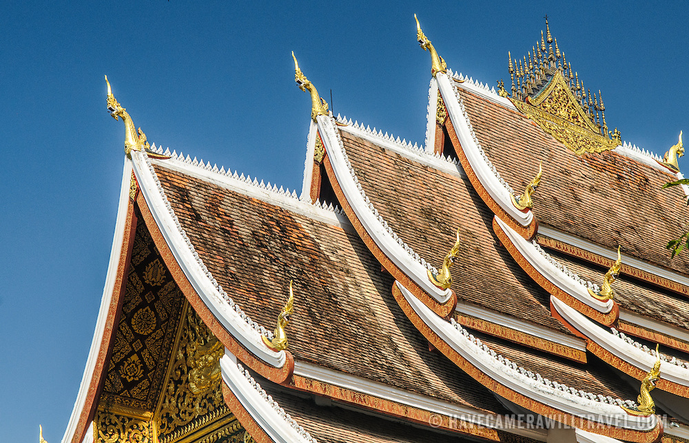 The multi-tiered roof at Haw Pha Bang (or Palace Chapel) at the Royal Palace Museum in Luang Prabang, Laos. The chapel sits at the northeastern corner of the grounds. Construction started in 1963.