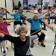 Mary Tavárez, front, 77, uses resistance bands in a chair aerobics class at Cross Roads Senior Center Thursday, November 2, 2017, in McAllen. <br /> Photo by Nathan Lambrecht