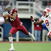 South Carolina Gamecocks wide receiver Shaq Roland (4) makes a  reception past Wisconsin Badgers cornerback Sojourn Shelton (8) during the NCAA Capital One Bowl football game between the South Carolina Gamecocks who represent the SEC and the Wisconsin Badgers who represent the Big 10 Conference, at the Florida Citrus Bowl on Wednesday, January 1, 2014 in Orlando, Florida. (AP Photo/Alex Menendez)