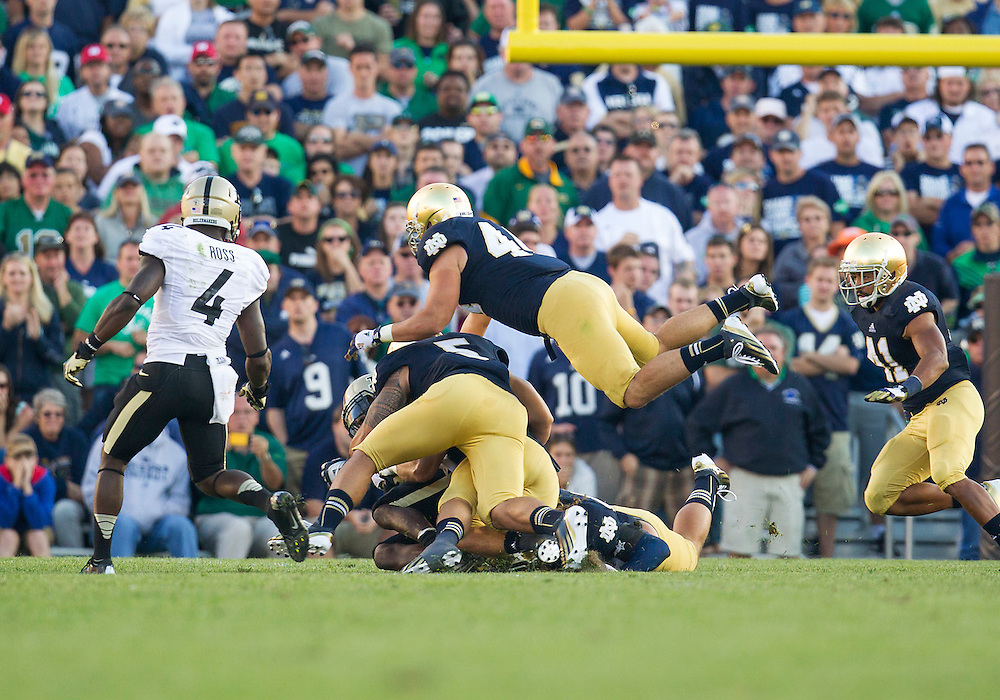 September 08, 2012:  Notre Dame defense gang tackles Purdue running back during NCAA Football game action between the Notre Dame Fighting Irish and the Purdue Boilermakers at Notre Dame Stadium in South Bend, Indiana.  Notre Dame defeated Purdue 20-17.