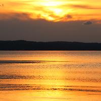 """Shimmer and Glow""<br /> <br /> Shimmering golden sunset over water!<br /> <br /> Sunset Images by Rachel Cohen"