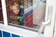 Young Kasper visiting at his grandparents' home in Sorland, Vaeroy Island, Lofoten Islands, Norway.