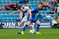 Rochdale  defender Joe Bunney (39) and Gillingham FC midfielder Dean Parrett (8) during the EFL Sky Bet League 1 match between Gillingham and Rochdale at the MEMS Priestfield Stadium, Gillingham, England on 30 March 2019.