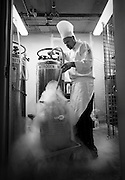 """SHOT 7/10/09 10:26:20 AM - Ian Kleinman, Chef and GM at O's Steak and Seafood at the Westin in Westminster, fills a temporary storage container with liquid nitrogen as he prepares to work in his kitchen at O's Steak and Seafood Restaurant at The Westin in Westminster, Co. Some might describe him as part mad scientist and part chef while using some unorthodox techniques to create unique and memorable dishes. Kleinman said he hopes to create a memorable experience for his guests and challenge them a bit while dining mainly through extraordinary technique and added, """"I'm just trying to have fun, I call it gastro fun"""".. (Photo by Marc Piscotty / © 2009)"""