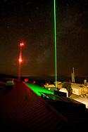 Green LIDAR laser shoots into the starry sky at the Mauna Loa Observatory, Hilo, Hawaii.