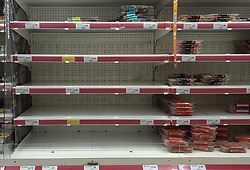 © Licensed to London News Pictures. 20/09/2021. London, UK. Empty shelves of meat products in Sainsbury's in north London as fears of food shortages grow after two of the UK's biggest Carbon Dioxide (CO2) producers halted production last week due to soaring gas prices. Photo credit: Dinendra Haria/LNP