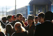 People gather at the Wien Westbahnhof train station as migrants pass through Vienna, Austria, September 6 2015.  Hundreds of migrants have resumed their journey through Austria to Germany after Hungary's decision on Friday to let them through.