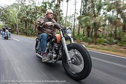 Eric Stein on his 1964 Harley-Davidson Panhead riding through Tomoka State Park during Daytona Beach Bike Week. FL. USA. Tuesday, March 14, 2017. Photography ©2017 Michael Lichter.