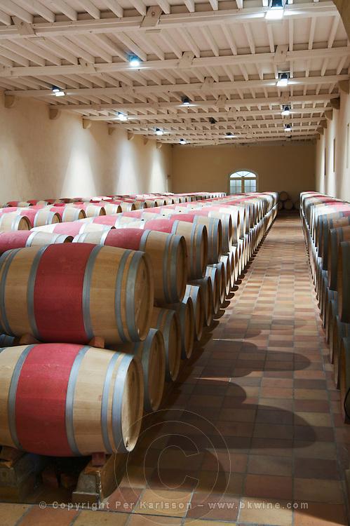 barrel aging cellar chateau phelan segur st estephe medoc bordeaux france