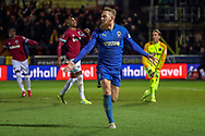 AFC Wimbledon midfielder Scott Wagstaff (7) celebrating after scoring goal to make it 1-0 during the The FA Cup match between AFC Wimbledon and West Ham United at the Cherry Red Records Stadium, Kingston, England on 26 January 2019.