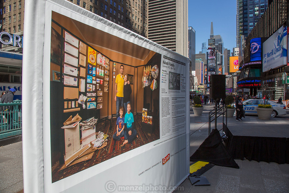 New York City, NY. Photo exhibit by Peter Menzel and Faith D'Aluisio, in Times Square, of One Week's Recycling & Trash of Eight US families.