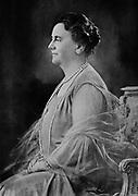 Wilhelmina (Wilhelmina Helena Pauline Maria: 1880-1962)  Queen regnant of the Kingdom of the Netherlands from 1890-1948. Three-quarter length profile photographic portrait of Queen Wilhelmina seated.