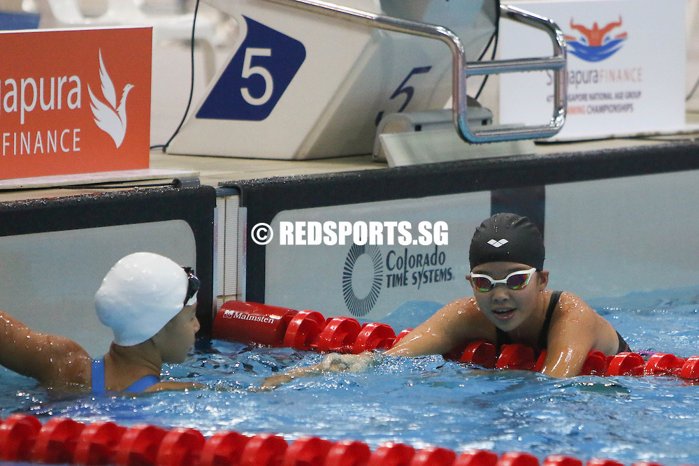 Dasha Ang (right) congratulating Claresa Liau after their 50m breaststroke event. Both 12, Claresa finished first with a timing of 36.56s, while Dasha was fourth in 38.30s. (Photo © Chua Kai Yun/Red Sports)