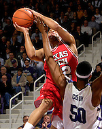 Texas Tech guard Jarrius Jackson (22) drives and scores over Kansas State center Luis Colon (50) in the first half at Bramlage Coliseum in Manhattan, Kansas, January 8, 2007.  Texas Tech defeated K-State 62-52.