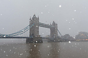 Tower Bridge is seen during a heavy snow shower on December 10th, 2017. Much of the UK has been hit by heavy snow and The Met Office have issued a yellow weather warning for snow and ice across most of the United Kingdom.