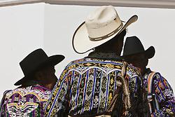 Cowboys in market, Sololá, Guatemala