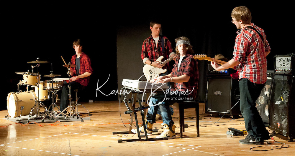 Charlie Weinmann, Sean McDonald, Kevin Ashley and Ian Sleeper  brought the house down with their classic rock medley to earn first place in the LHS Talent Show Wednesday evening.   (Karen Bobotas/for the Laconia Daily Sun)