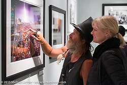 "Checking out the details in ""Lightning Strikes"" print of a Kid Rock concert by Michael Lichter in his Motorcycles as Art annual exhibition titled ""The Naked Truth"" at the Buffalo Chip Gallery during the 75th Annual Sturgis Black Hills Motorcycle Rally.  SD, USA.  August 4, 2015.  Photography ©2015 Michael Lichter."