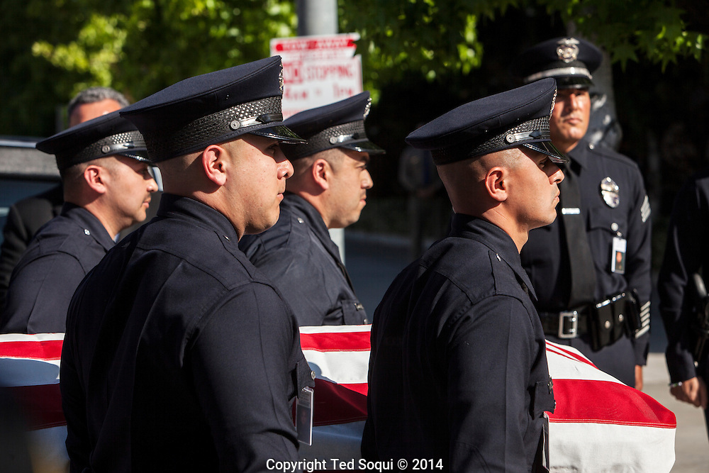 LAPD Officers carry the remains of LAPD Officer Sanchez in to the Cathedral.<br /> Funeral Mass for LAPD Officer Roberto Sanchez held at the Cathedral of Our Lady of the Angels in Los Angeles. Officer Sanchez was killed while on duty during a police pursuit, when a suspects vehicle intentionally rammed Sanchez's LAPD cruiser.