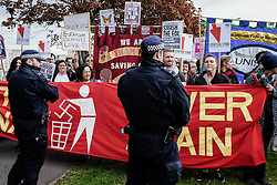 Police form a cordon as anti-fascists gather to protest against a march held by the English Defence League. May 2015, Walthamstow London