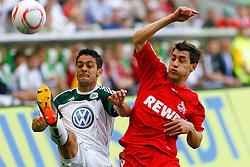 24.04.2010, Volkswagen Arena, Wolfsburg, GER, 1.FBL, VfL Wolfsburg vs 1.FC Koeln, im Bild Josue (Wolfsburg #7) und Mato Jajalo (Koeln #19) .EXPA Pictures © 2011, PhotoCredit: EXPA/ nph/  Schrader       ****** out of GER / SWE / CRO  / BEL ******