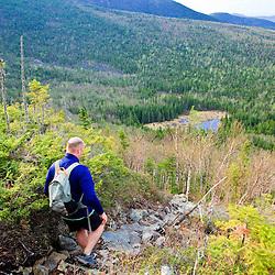 A man hikes the Appalachian Trail on Crocker Mountain in Stratton, Maine.
