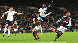 4 January 2018 - Premier League Football - Tottenham Hotspur v West Ham United - Davinson Sanchez of Tottenham leaps acrobatically for the ball - Photo: Charlotte Wilson / Offside