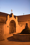 Church gate at dusk under clear sky, San Pedro de Atacama, Atacama desert, Chile.