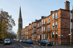 View of red sandstone tenement apartment blocks on Balvicar Drive in Queen's Park district of Glasgow, Scotland, United Kingdom