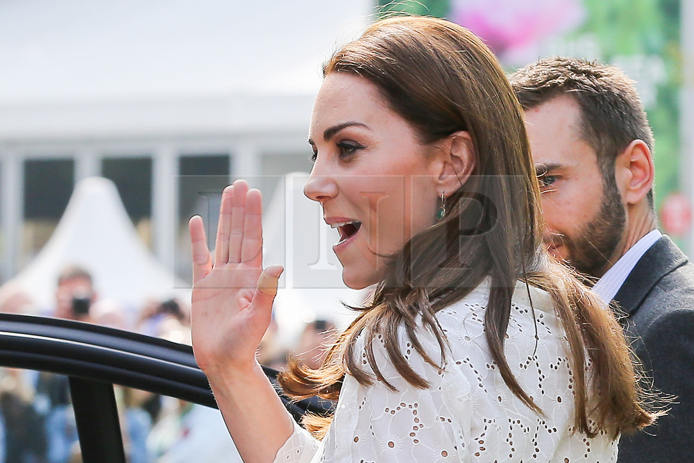 """© Licensed to London News Pictures. 20/05/2019. London, UK. Duchess of Cambridge departed after visiting her 'Back to Nature' garden at the Chelsea Flower Show. The  'Back to Nature' garden is designed along with the Royal Horticultural Society and landscape architects Davies White which includes a swing seat, hanging below the garden's centrepiece, a high platform tree house as well as """"incredible edibles, plants for craft activities, forest scents and a diverse range of plants, shrubs and trees of different heights and textures,""""<br /> The Royal Horticultural Society Chelsea Flower Show is an annual garden show held over five days in the grounds of the Royal Hospital Chelsea in West London. The show is open to the public from 21 May until 25 May 2019. Photo credit: Dinendra Haria/LNP"""