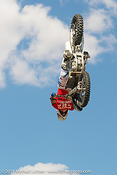 Vince Morgan's freestyle motocross team jumping at Arizona Bike Week's Cycle Fest at Westworld. USA. April 5, 2014.  Photography ©2014 Michael Lichter.