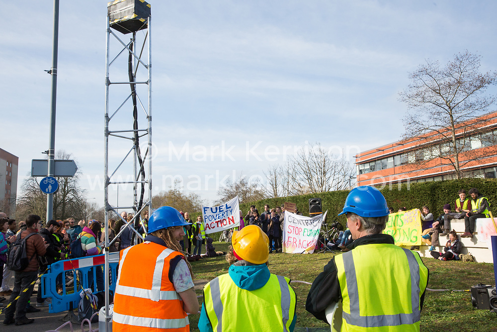 Windsor, UK. 22nd February, 2019. Around 60 campaigners from Reclaim the Power and Fuel Poverty Action set up a mock fracking site during a family-friendly protest outside the headquarters of Centrica to call on the British multinational energy and services company to cease its support for fracking operations through its partnership with shale gas company Cuadrilla Resources.