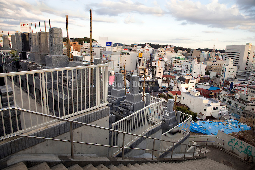 Japanese urban city center with terraced cementery grave stones Yokosuka