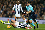 Borja Baston of Swansea city breaks away from Jonas Olsson of West Bromwich Albion. Premier league match, West Bromwich Albion v Swansea city at the Hawthorns stadium in West Bromwich, Midlands on Wednesday 14th December 2016. pic by Andrew Orchard, Andrew Orchard sports photography.