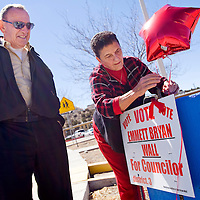 031213       Cable Hoover<br /> <br /> District 3 city council candidate Emmett Bryan Wall, left, watches as his wife, Rose Ferrari, ties a balloon to his campaign sign near the polling station at Jefferson Elementary School in Gallup Tuesday.