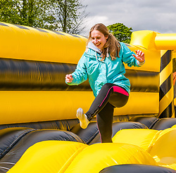 Pictured: Labyrinth Inflatable Course. Dalkeith Country Park, Midlothian, 04 May 2019. The Labyrinth Challenge is the World's longest, continuous, widest inflatable obstacle course with a series of interactive and wacky obstacles with five  themed zone, and measures over 1000ft in length.<br /> Sally Anderson | EdinburghElitemedia.co.uk