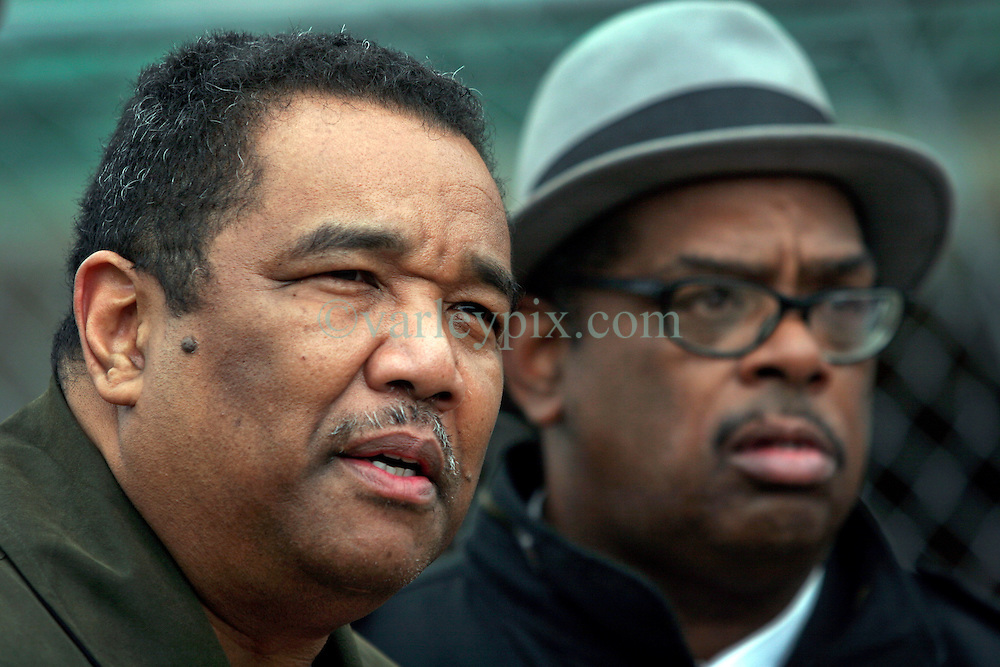 02 March 2010. New Orleans, Louisiana, USA. <br /> Civil Rights leaders gather at the notorious Danziger Bridge in New Orleans East, scene of the Sunday Sept 4th, 2005 murder of 40 yr old Ronald Madison and 19 yr old James Brissette by New Orleans police. <br /> Doctor Romell Madison (left), brother of victim Ronald Madison  revisits the scene of his brother's death.<br /> The police are under federal investigation for an alleged cover up of the botched killings in the chaotic aftermath of hurricane Katrina. <br /> Photo; Charlie Varley.