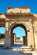 The Mazeus Mithridates Gate to the Agora of Ephesus takes its name from the 2 Freed slave of  Emperor Augustus who paid for its contruction. It is dedicated to Emperor Augustus, his wife Livia , his daughter Julia and her husband Agrippa. Built in 4 or 3 B.C. Ephesus Archaeological Site, Anatolia, Turkey. .<br /> <br /> If you prefer to buy from our ALAMY PHOTO LIBRARY  Collection visit : https://www.alamy.com/portfolio/paul-williams-funkystock/ephesus-celsus-library-turkey.html<br /> <br /> Visit our TURKEY PHOTO COLLECTIONS for more photos to download or buy as wall art prints https://funkystock.photoshelter.com/gallery-collection/3f-Pictures-of-Turkey-Turkey-Photos-Images-Fotos/C0000U.hJWkZxAbg