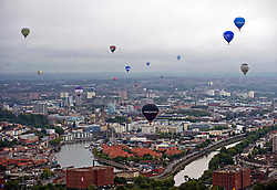© Licensed to London News Pictures. 12/08/2011. Bristol, UK. The Hot Air Balloon MAss Ascent on day two of  the 2011 Bristol Balloon Fiesta today (12/08/2011) in which over 60 hot air balloons take off at the same time over Bristol. Photo credit: Ben Cawthra/LNP