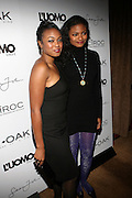 """Tantyana Ali and Anastasia Ali pictured at the cocktail party celebrating Sean """"Diddy"""" Combs appearance on the """" Black on Black """" cover of L'Uomo Vogue's October Music Issue"""