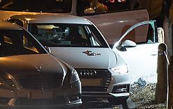 © Licensed to London News Pictures. 03/01/2017. Huddersfield, UK. A bullet riddled white Audi car at the slip road at Junction 24 of the M62 motorway in Huddersfield . West Yorkshire police have announced a man has died following the discharge of a police firearm , during what they describe as a pre-planned operation , yesterday evening (2nd January 2017) . Photo credit : Joel Goodman/LNP