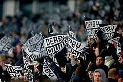 Derby County fans in the stands waves flags to show their support